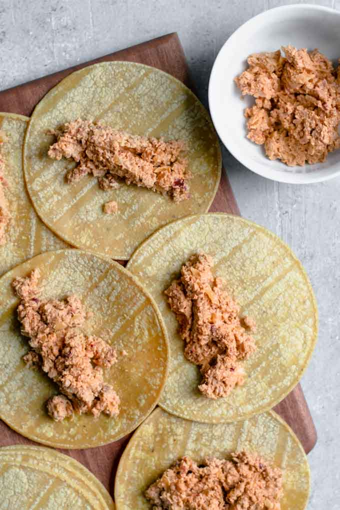 corn tortillas filled with the cheesy beefy filling before being rolled into taquitos