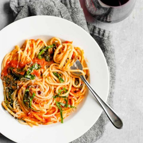classic homemade marinara with spinach and garnished with fresh basil