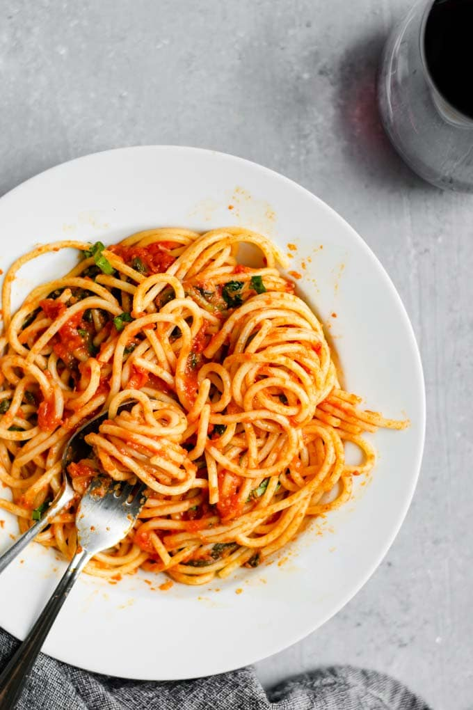 spaghetti with homemade marinara and sautéed spinach