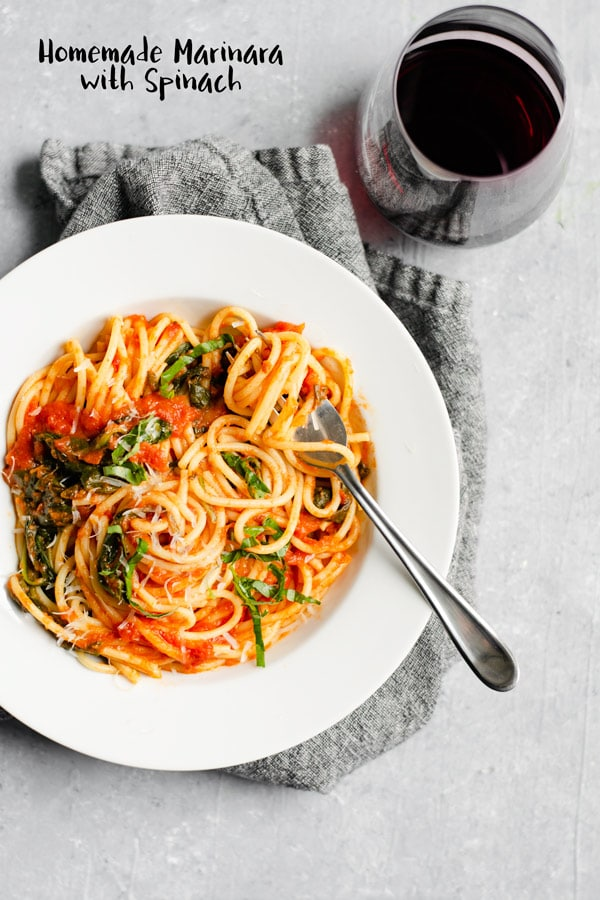 There is nothing as delicious as this classic homemade marinara sauce. It's easy to make and packs more flavor than any store bought version. Add spinach for a nutritionalboost you won't even notice! | thecuriouschickpea.com #vegan #italianfood #veganItalian #marinara #glutenfree
