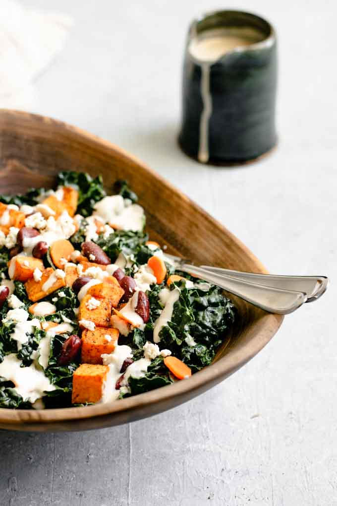 kale salad with roasted garlic tahini dressing, ancho roasted sweet potatoes, and kidney beans