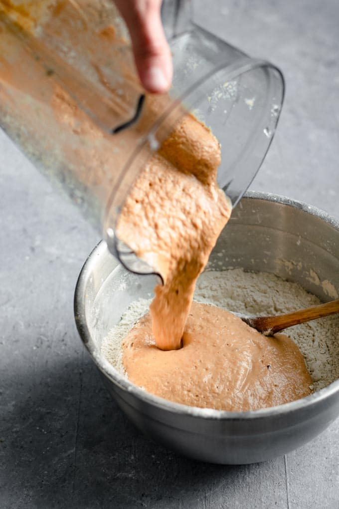 pouring the liquid mixture to the dry for making seitan