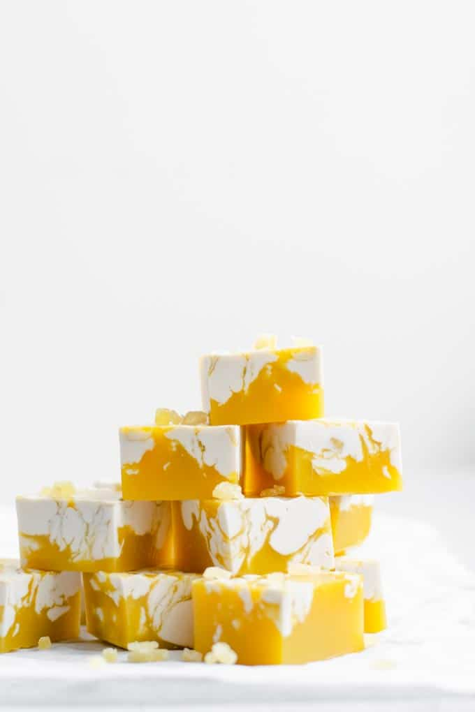 stack of vegan mango jalapeño jellies with a ginger cream swirl and garnished with chopped crystallized ginger