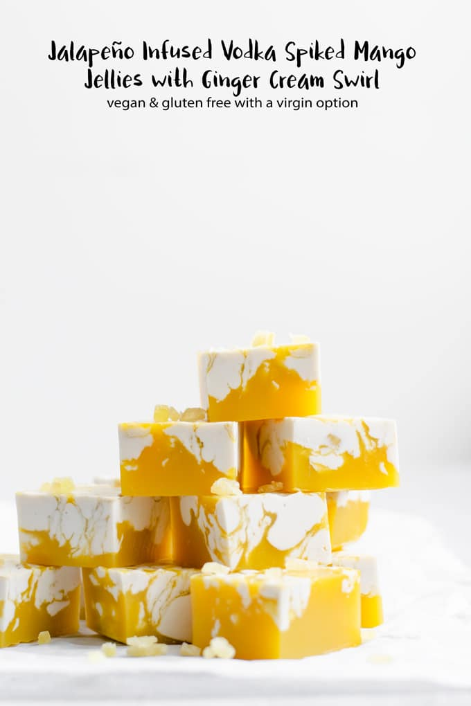 These sophisticated vegan jello shots are made with a jalapeño infused vodka and mango cocktail, with a zippy ginger cream swirl. Make them virgin for a kid-friendly and sober treat! | #thecuriouschickpea #vegan #mango #jelloshot #vodka