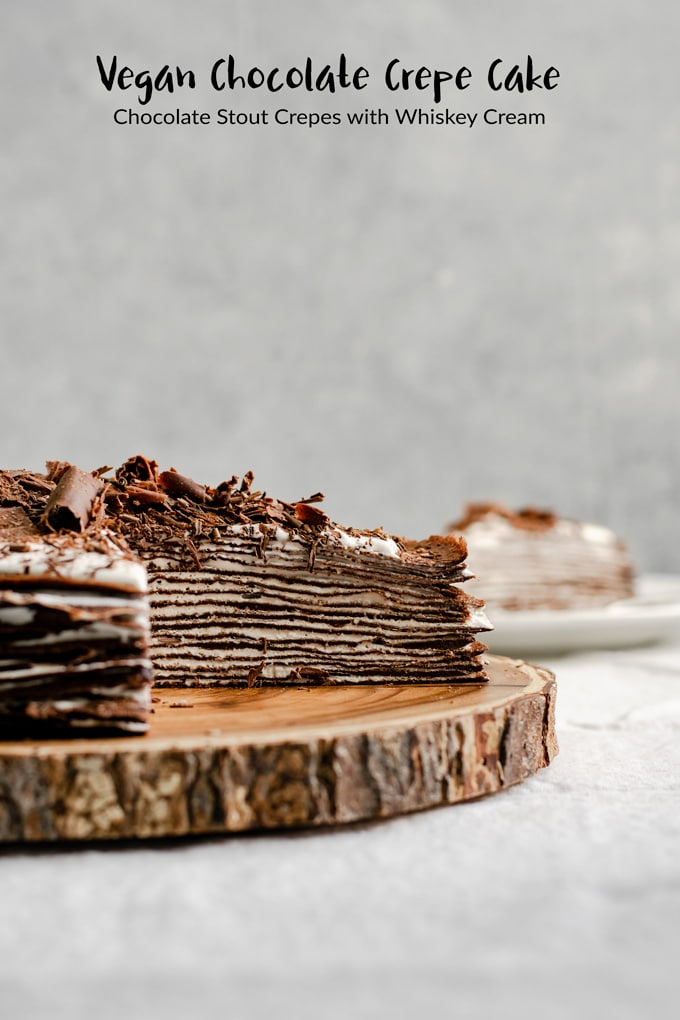 This beautiful dark chocolate crepe cake is made with chocolate beer crepes and filled with a whiskey whipped cream filling. It's a rich and delicious and completely vegan! #thecuriouschickpea #vegan #dessert #chocolate #cake