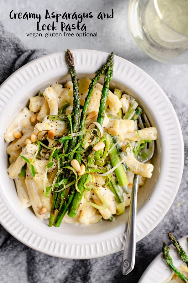 This creamy vegan pasta dish is stuffed full of asparagus and leeks. It's easy and quick to make, full of flavor, and is also vegan with a gluten free option! It's the perfect recipe for spring! #thecuriouschickpea #vegan #pasta #asparagus #veganpasta #leeks #glutenfree #healthy