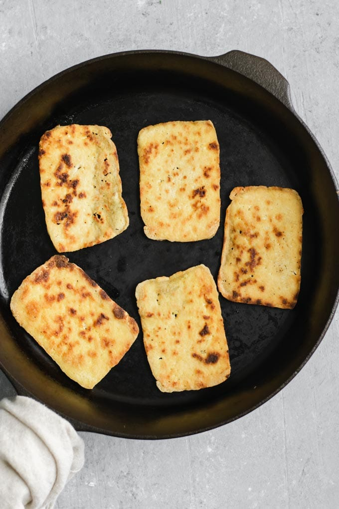 frying the thinly sliced tofu for the barbecue tofu