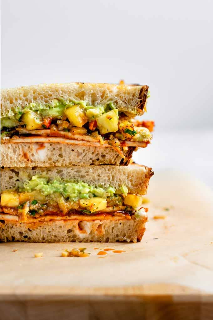 close up of the barbecue tofu sandwich filling with pineapple relish and mashed avocado