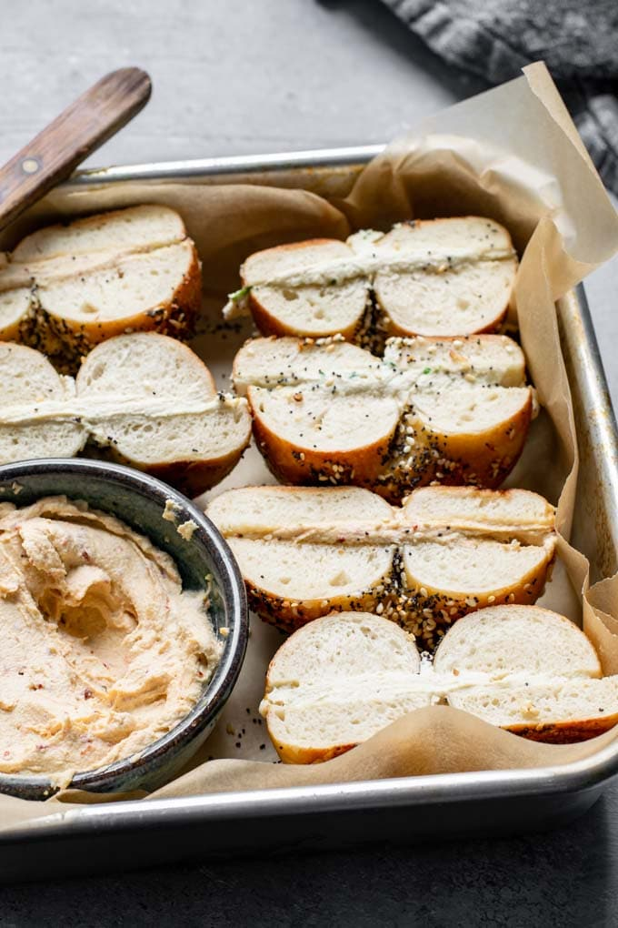 Bagels filled with vegan cultured cashew cream cheese and cut in half