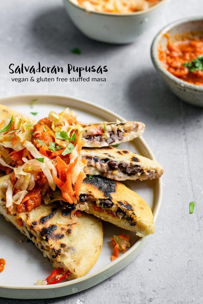 These homemade pupusas are a classic Salvadoran recipe, stuffed with black beans and vegan cheese and topped with curtido and salsa roja. #thecuriouschickpea #vegan #glutenfree #blackbeans #pupusas #salvadoran #masa #vegansnack #veganappetizer #veganentree