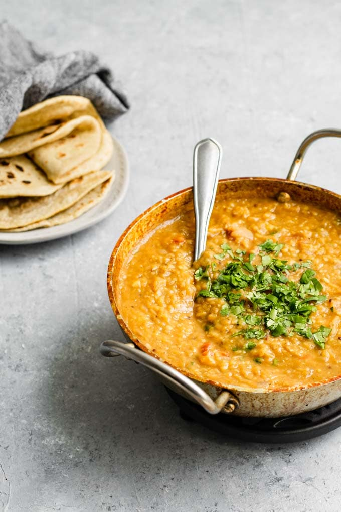 cooked masoor dal tadka served with some chapati
