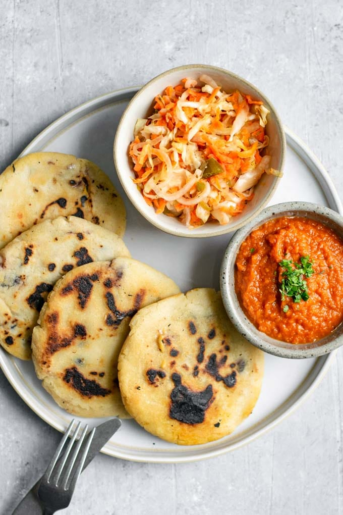 salvadorian curtido served with pupusas and salsa roja