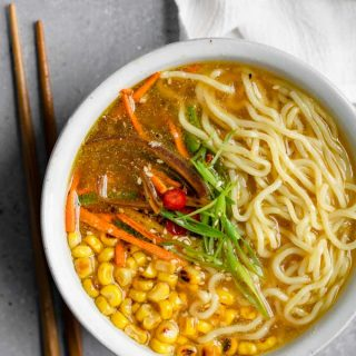 vegan ramen with miso tahini broth, charred corn, and carrots and jalapeño