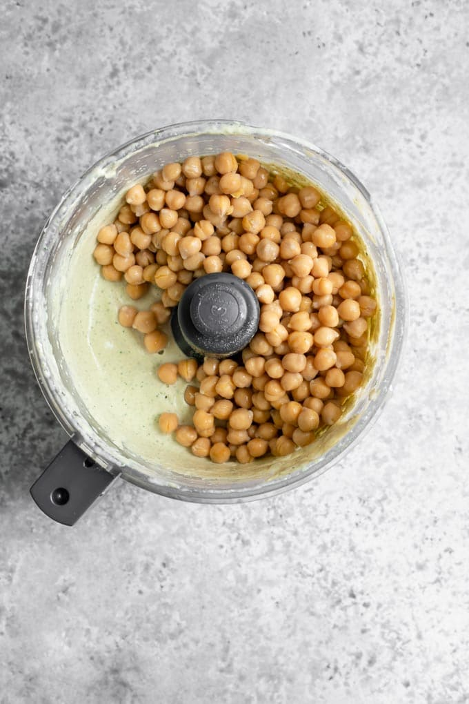 chickpeas added to the tahini emulsion to make hummus