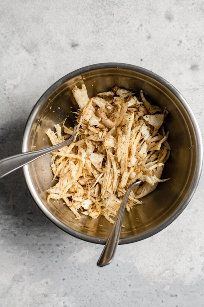 shredded king oyster mushrooms tossed with a dry rub and olive oil