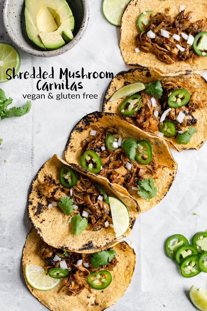 Enjoy these vegan carnitas, made from shredded king oyster mushrooms for an ultra flavorful, delicious, meaty, and easy recipe! They're perfect for stuffing into tacos, burritos, and more! #vegan #glutenfree #veganentree #vegantacos #tacos #mexican