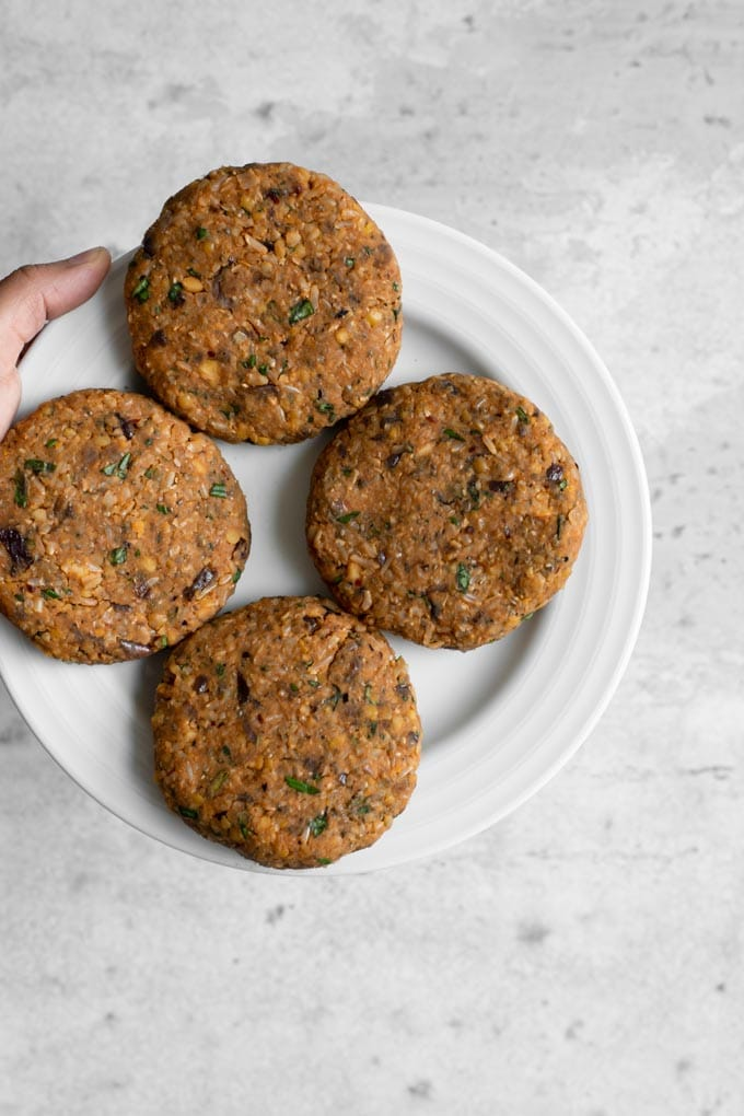 the herbed chickpea burger patties formed and ready to cook