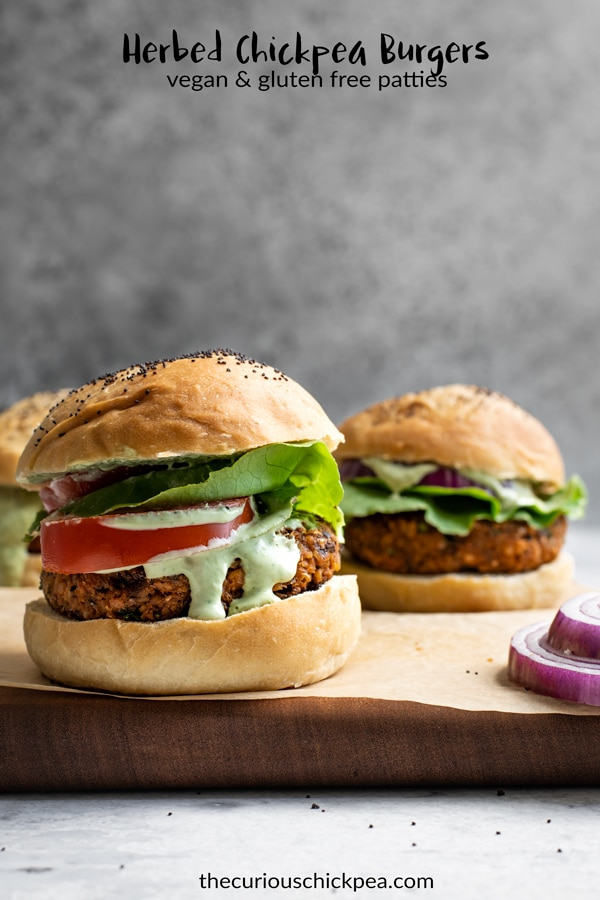 These herbed chickpea burgers are a delicious vegan and gluten free veggie burger. They're super easy to make and packed with flavor! Perfect for grilling season! #thecuriouschickpea #chickpeaburger #veggieburger #veganburger #glutenfreeburger