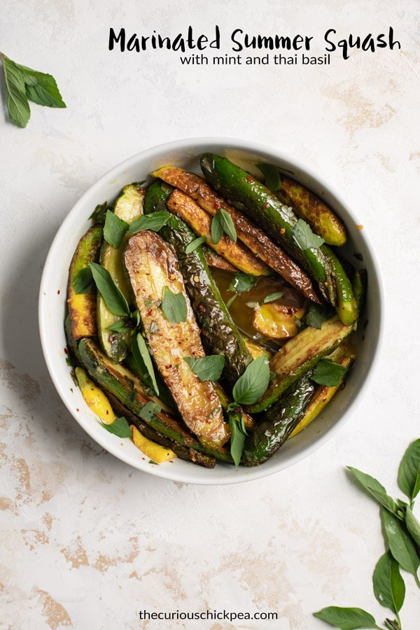 Marinated zucchini is one of the most delicious ways to enjoy summer squash! This one is made with a basil and mint infused olive oil. It's the perfect appetizer or side dish, and serve it with some crusty bread to soak up the flavorful oil! | thecuriouschickpea.com #vegan #sidedish #zucchini #summersquash #glutenfree #vegetables