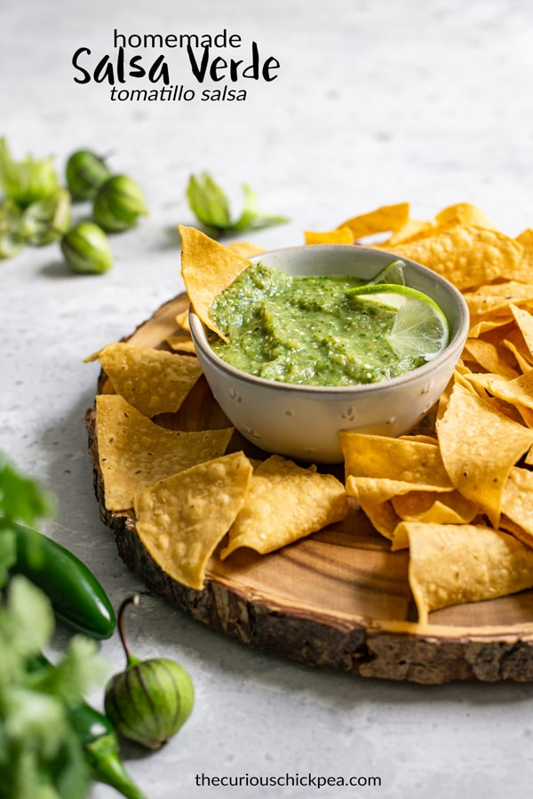 Homemade salsa verde is a delicious Mexican sauce made from tomatillos. This easy salsa is a little smoky, a bit spicy, a bit sweet, and addictively delicious. It's ready in almost no time! | thecuriouschickpea.com #salsa #salsaverde #homemadesalsa #mexicanfood #vegan #vegetarian #glutenfree