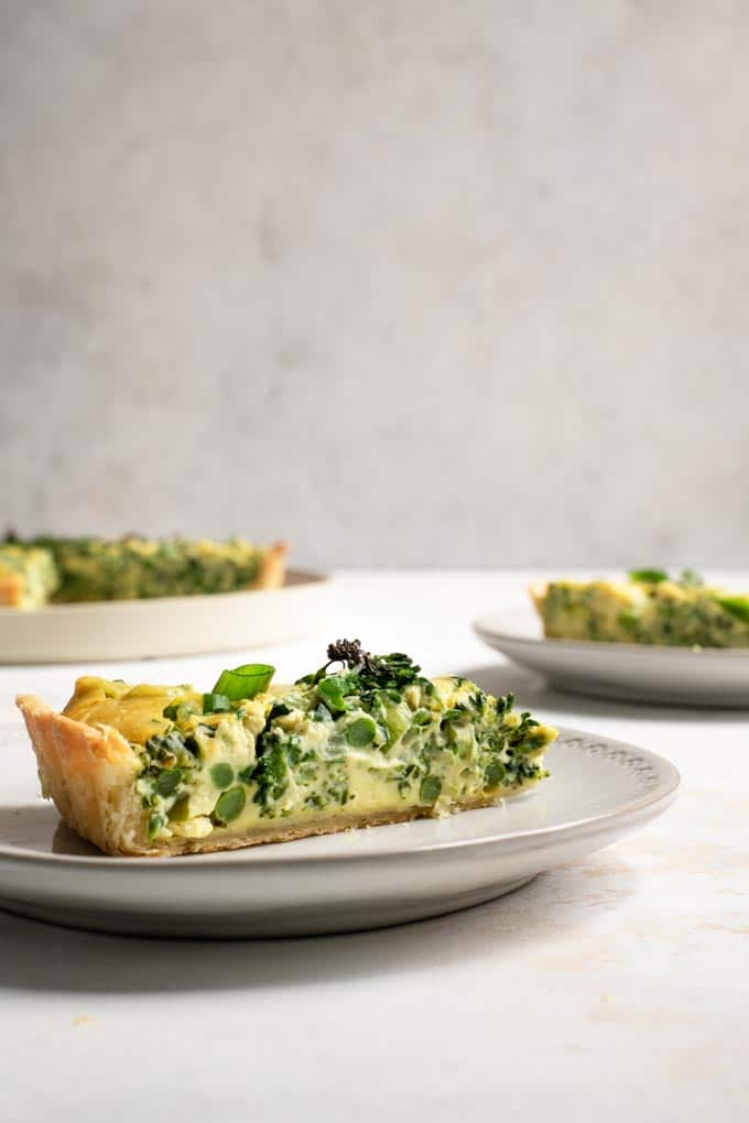 side view of a slice of the sprouting broccoli quiche, showing the texture of the quiche