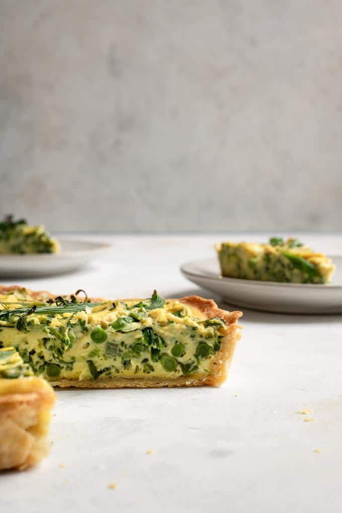 side view of the quiche, showing the texture and the sprouting broccoli stems