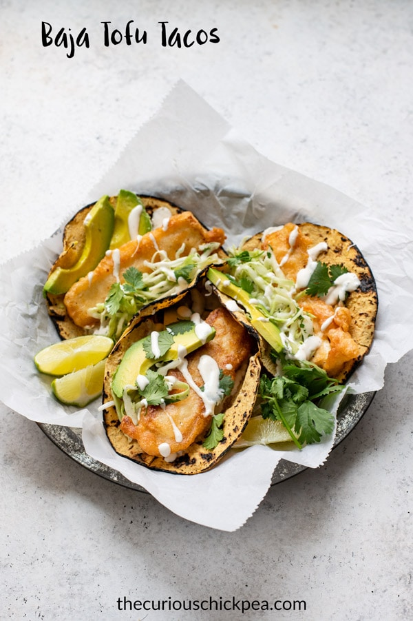 These Baja tofu tacos are a delicious vegan version of the popular fish tacos from Southern California. It doesn't get better than battered tofu cutlets, a creamy white sauce, and crisp cabbage slaw all wrapped in a corn tortilla! Can be made gluten free. #vegan #vegantacos #tacos #tofu #slaw #veganmexican #mexican #bajatacos