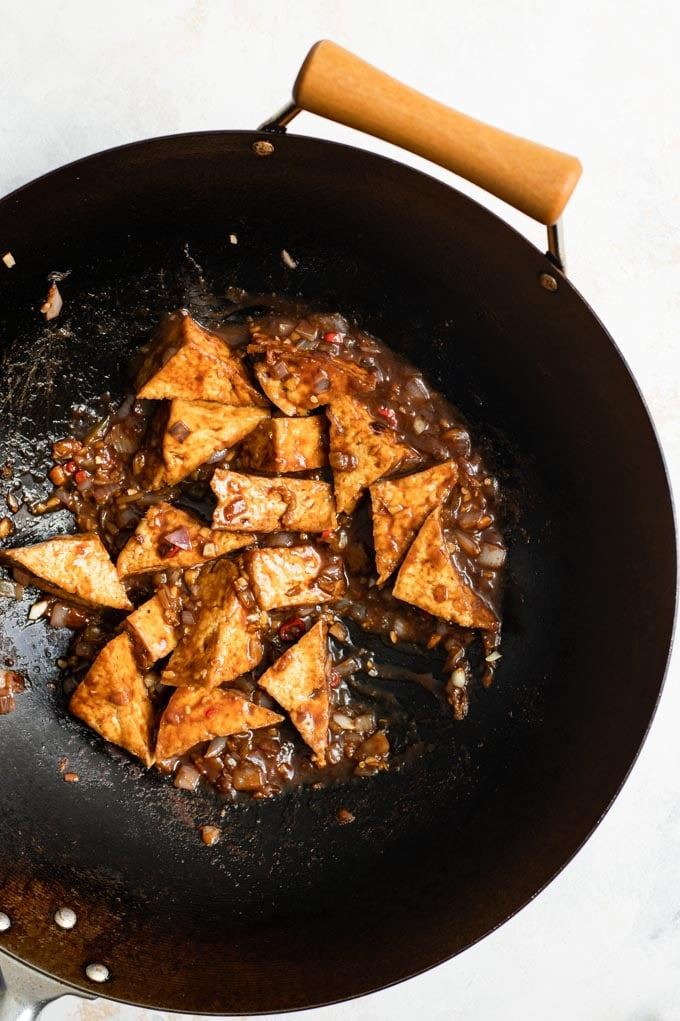 black bean sauce tofu cooking in a wok