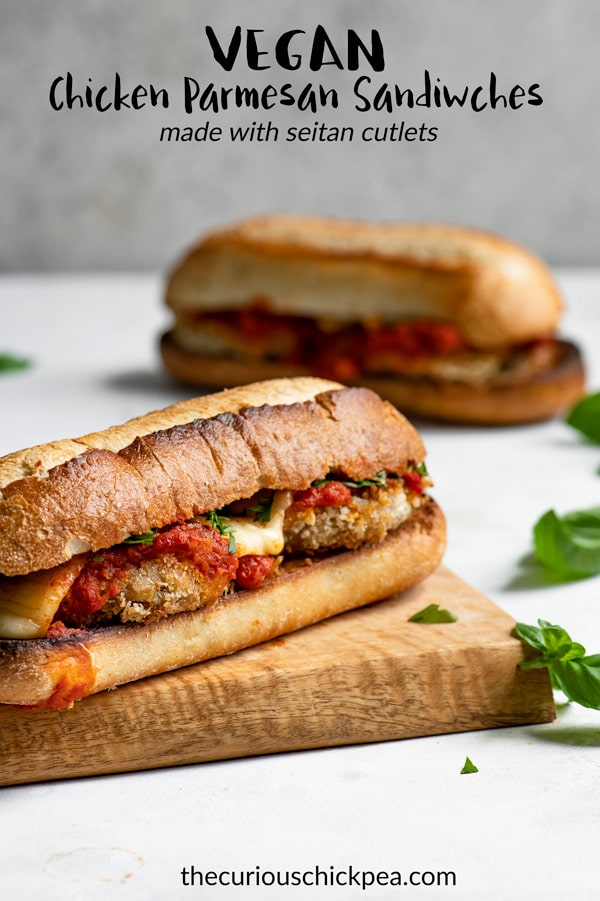 These vegan chicken parmesan sandwiches are even better than the classic! They're made with crispy breaded chickpea seitan cutlets (some gluten free options suggested) and smothered with marinara and vegan cheese. They'll satisfy any craving! #vegan #vegansandwich #sandwich #veganentree #veganmeal #vegancheese #seitan