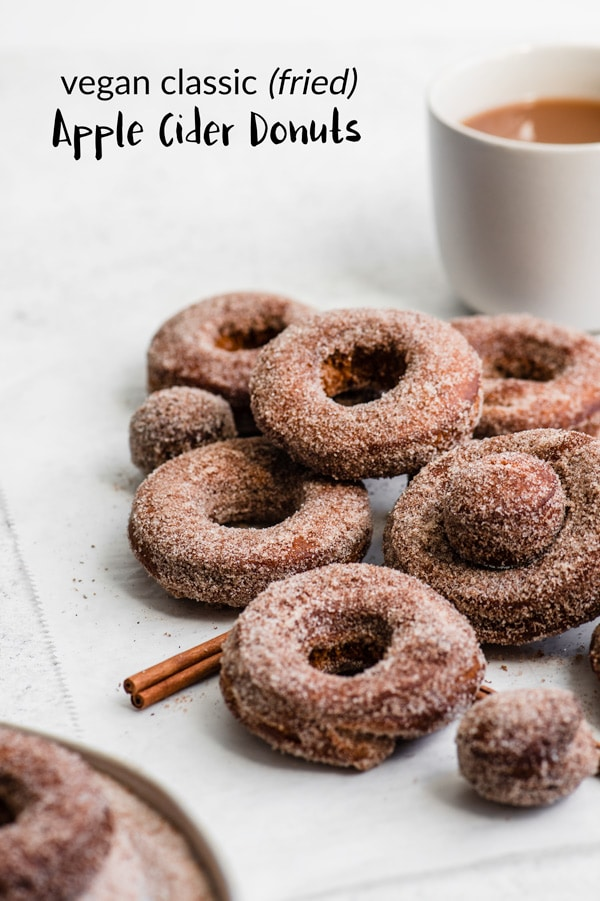 These classic apple cider donuts are made vegan! They're fried not baked, and delicious topped with cinnamon sugar or a maple cinnamon glaze! #vegandonuts #doughnuts #donuts #ciderdonuts #vegandoughnuts #vegan #vegandessert #dessert #applecider