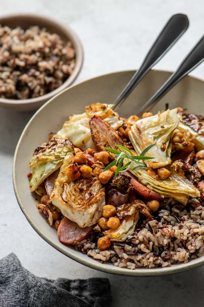sheet pan dinner in a bowl served with wild rice
