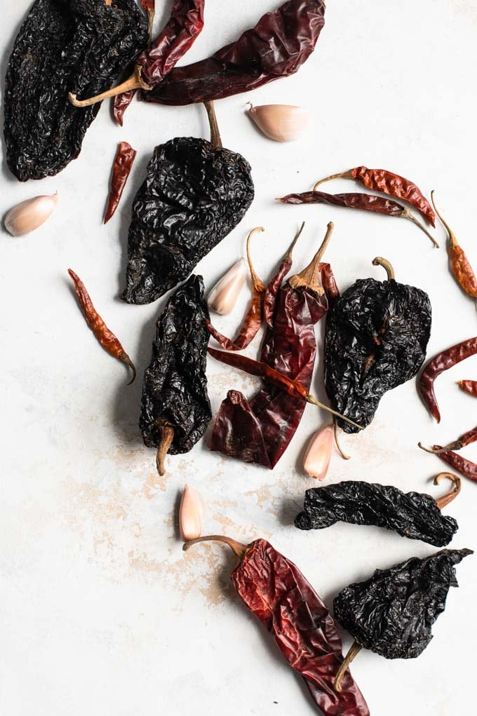 assortment of dried chiles and garlic cloves to make harissa