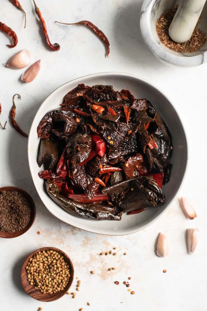 soaked dried chiles in a bowl