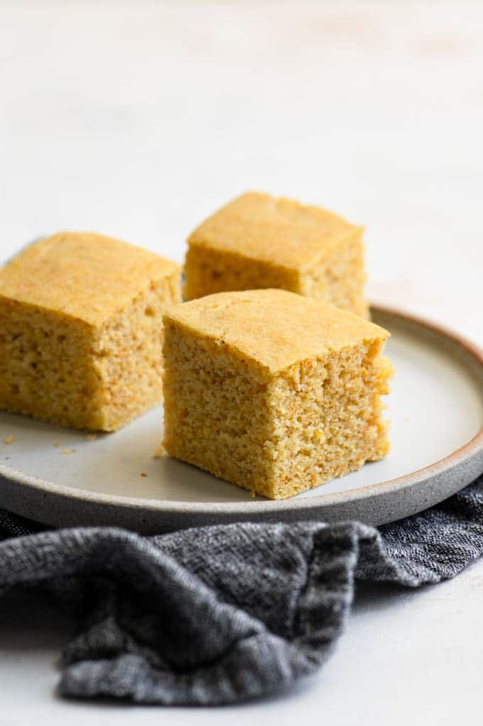 three pieces of cornbread on a plate