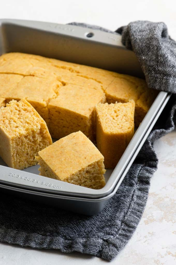 vegan cornbread cut in the baking dish