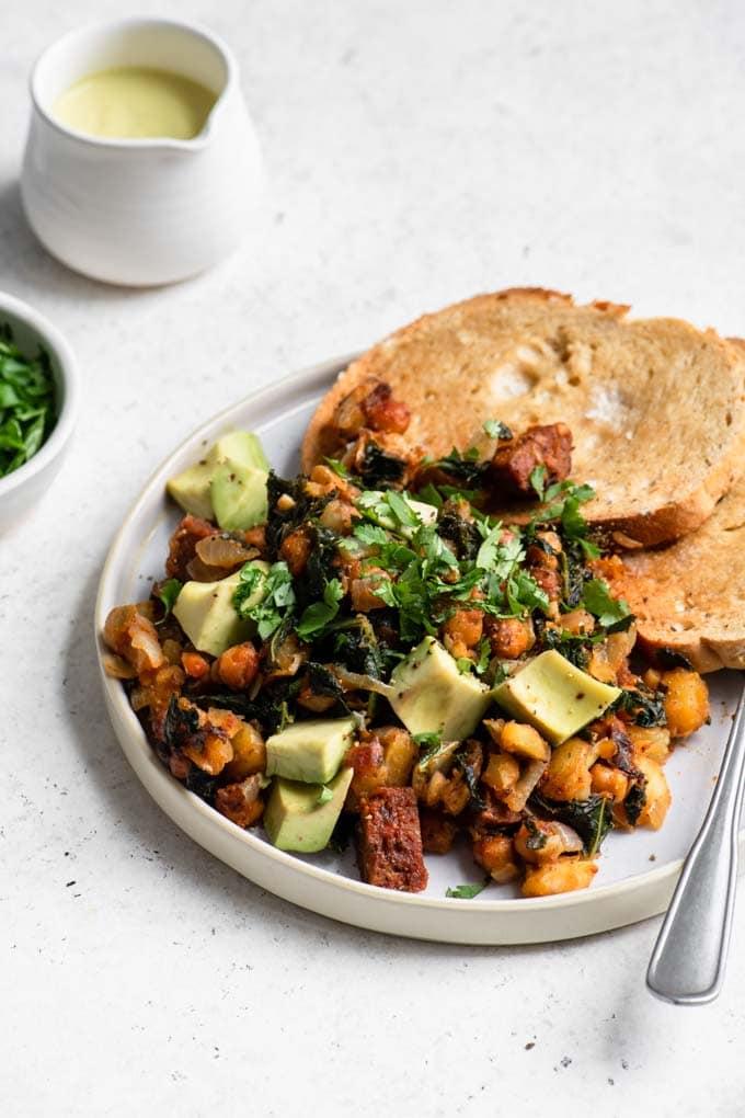 vegan chorizo hash with vegan hollandaise to serve