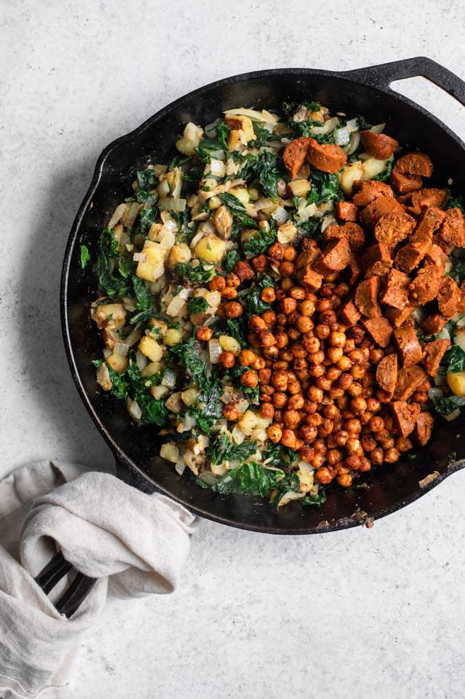 chorizo chickpeas and vegan sausage added to pan