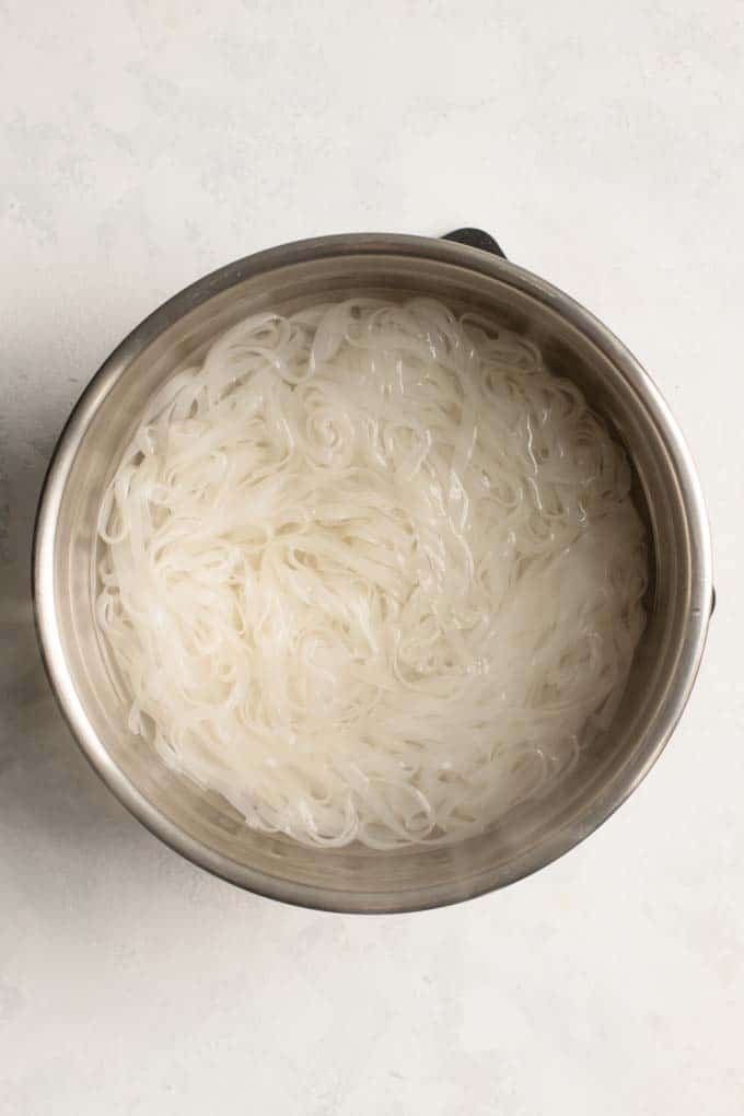 softened rice noodles in boiling water