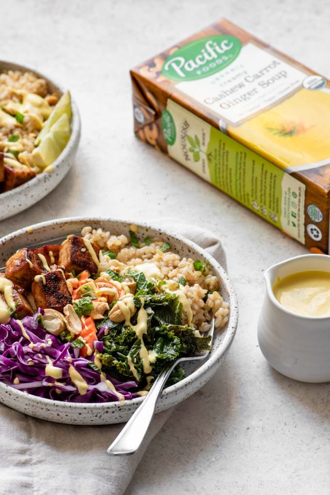 tofu buddha bowls with carrot ginger dressing and box of Pacific Foods soup used in the dressing