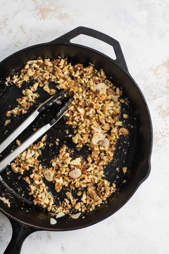 toasting walnuts and garlic in the pan