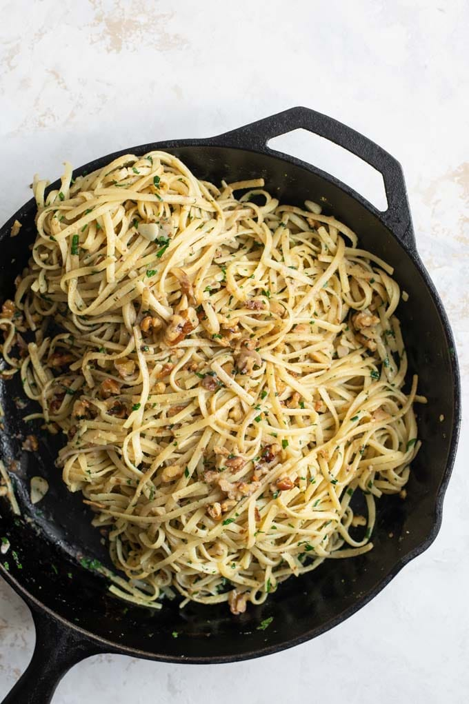 linguine tossed in the skillet with the walnut mixture