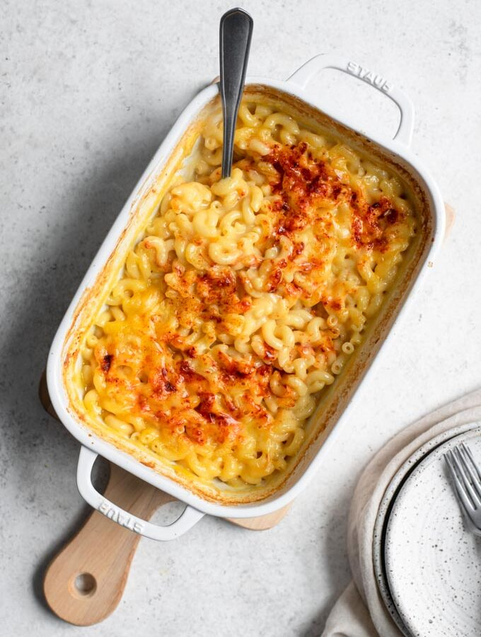 no boil mac and cheese in a white baking dish