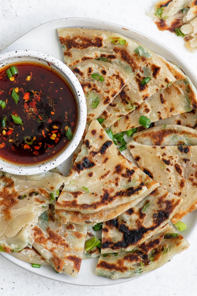 scallion pancakes cut into wedges and served with a soy dipping sauce