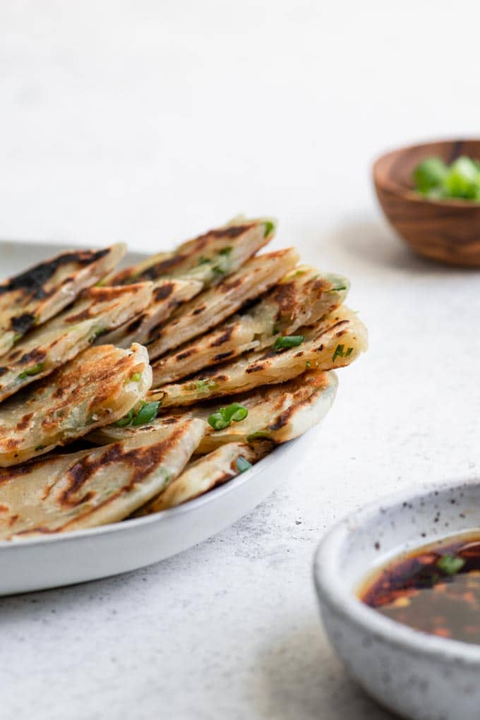 side view of scallion pancakes cut into wedges to show layers