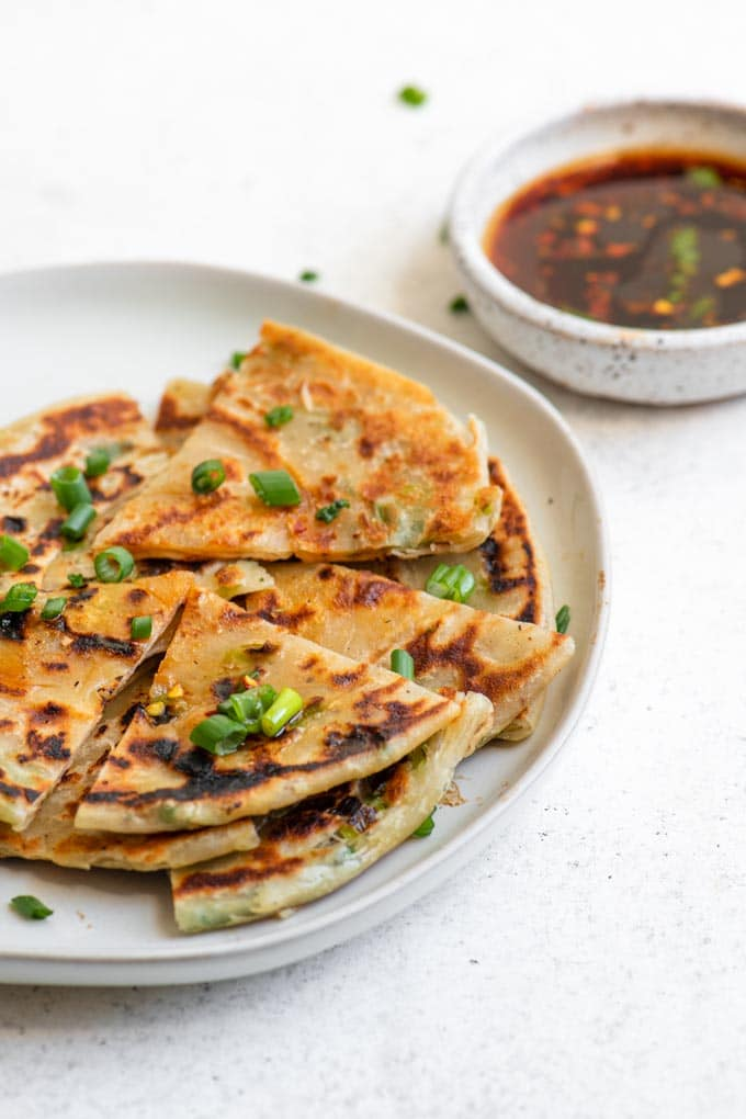 scallion pancakes topped with fresh scallion greens