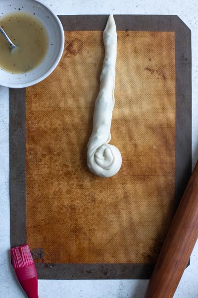 a half rolled spiral of dough