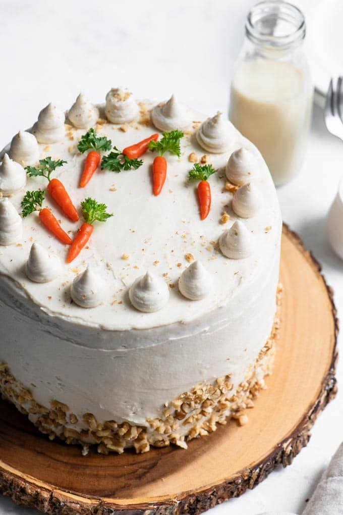 3 layer carrot cake with cream cheese frosting and marzipan carrot decorations