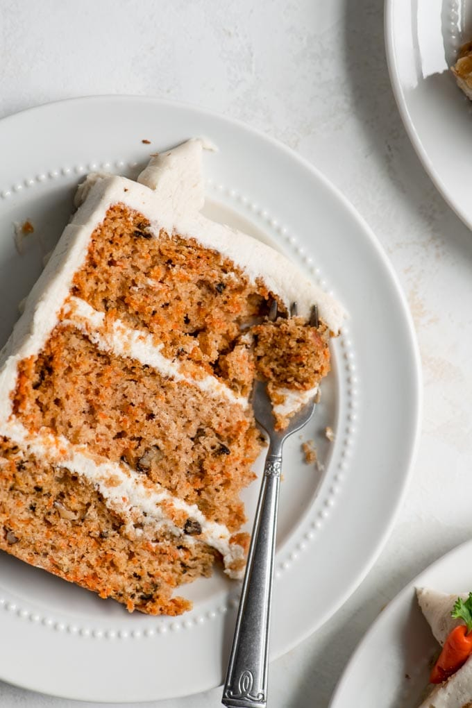 carrot cake slice with a bite on a fork