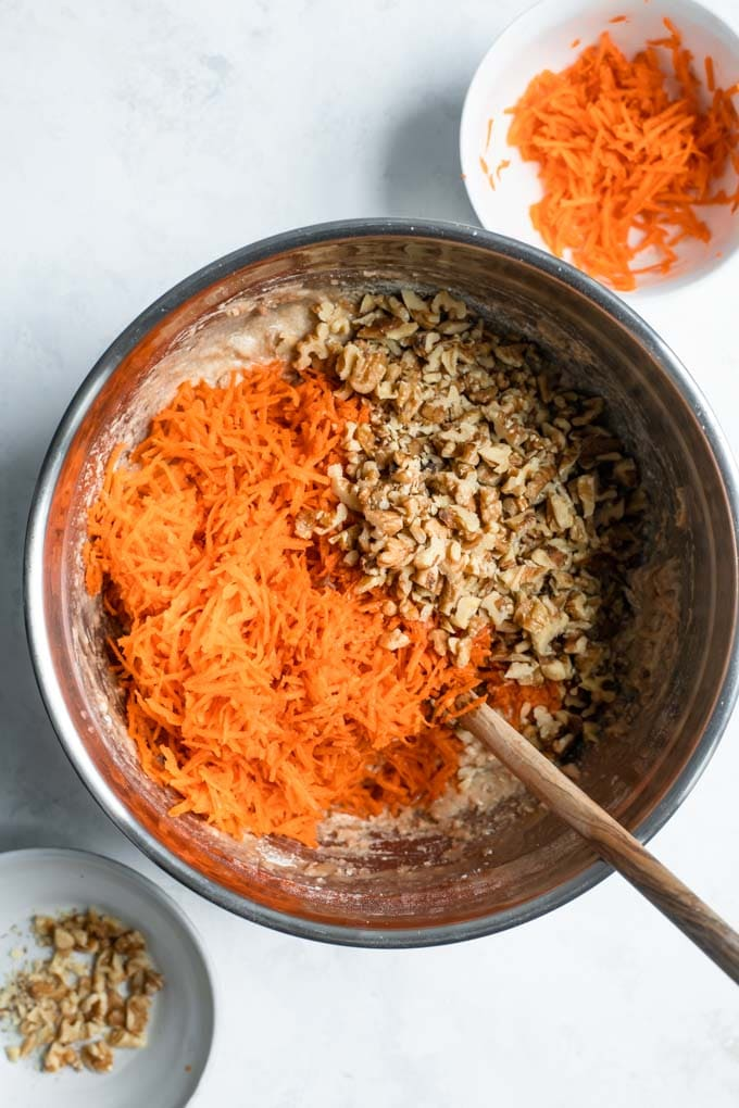 carrots and walnuts aded to carrot cake batter