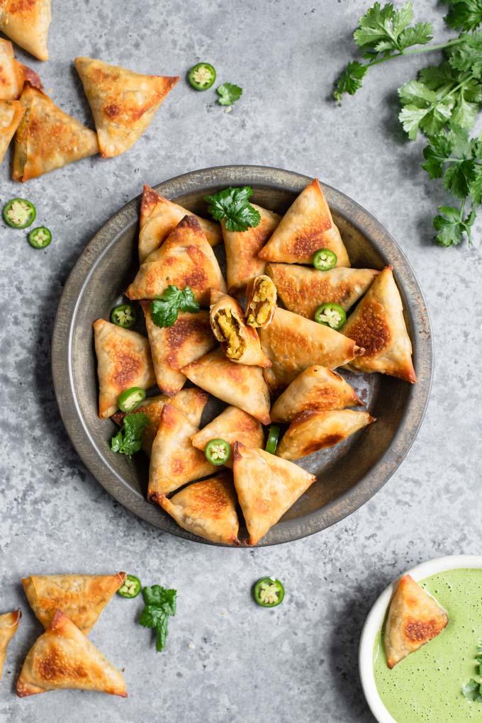baked samosa served with a cilantro mint chutney